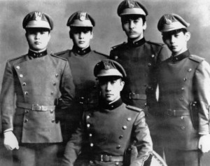 "From left to right: Hissho Horita, Hiroyasu Koga, Masahiro Ogawa, Nasayoshi Koga and Yukio Mishima (C), in Tokyo a few days before Mishima died. Japanese writer Yukio Mishima sits among the four men of ""Tatenokai"" (Shield association) who followed him when he attacked an Army office in Tokyo. The association is a militant youth group he had organized in 1968 for the purpose of reviving the old Japanese way of life, on the first anniversary of the society's foundation, 12 April 1970 in Tokyo. Mishima committed ""hara-kiri"", the traditional Japanese suicide, in protest against modern Japanese decadence 25 November 1970. (Photo credit should read STF/AFP/Getty Images)"